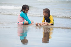 Little girls playing on the beach, family beach vacation Stock Image