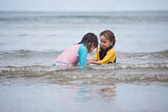 Little girls playing on the beach, family beach vacation stock photo