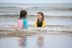 Little girls playing on the beach, family beach vacation Royalty Free Stock Image