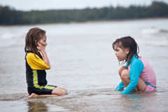 Little girls playing on the beach, family beach vacation Royalty Free Stock Photography