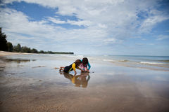 Little girls playing on the beach, family beach vacation Stock Photos