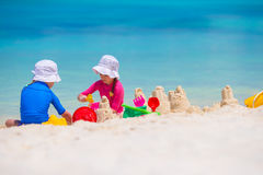 Little girls playing with beach toys during Royalty Free Stock Photography
