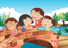 Little girls playing at the bridge. Illustration of the little girls playing at the bridge Stock Images