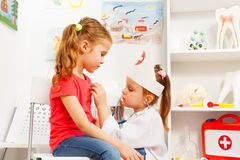Little girls playing doctor with stethoscope Stock Image