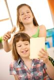 Little girls playing hairdresser Royalty Free Stock Images