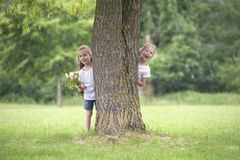 Little girls playing hide and seek Royalty Free Stock Photo
