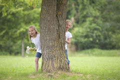 Little girls playing hide and seek Royalty Free Stock Image