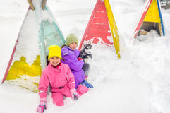 Little girls playing with Husky dog on the snow Royalty Free Stock Photo