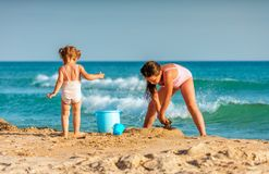 Free Little Girls Playing In The Sand On Black Sea Coast Beach At Anapa Resort While Spending Family Vacation Royalty Free Stock Photos - 153922228