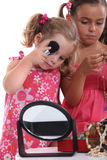 Little girls playing with mummy. 's makeup and jewelry Stock Images