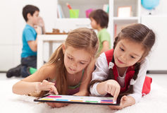Free Little Girls Playing On A Tablet Computing Device Stock Photo - 28920240
