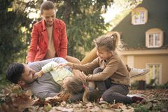 Little girls playing with parents, Girls tickling father. Leisure activity Royalty Free Stock Images