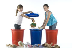 Little girls playing in a plastic drums Royalty Free Stock Photos