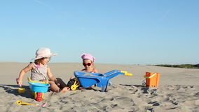 Little girls playing in sand. Two little girls playing in sand stock video footage