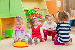Little girls playing with toys in  playroom Royalty Free Stock Image