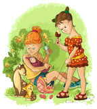 Little girls plays with a dolls. Children play with toys. To play house. Mothers and Daughters. Summer vacation theme Stock Images