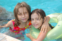 Little girls in the pool Stock Images