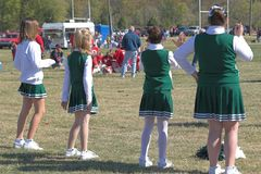Little Girls Practicing. Little cheer leaders practicing their moves for the football game Royalty Free Stock Photo