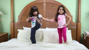 Little girls practicing their training. One for model and the other for Mixed Martial Arts stock video
