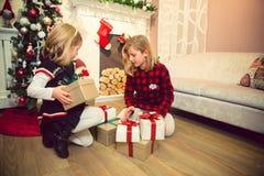 Little girls preparing presents Stock Images