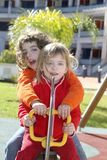 Little girls preschool playing park playground Stock Photo