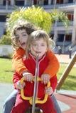 Little girls preschool playing park playground Stock Photo