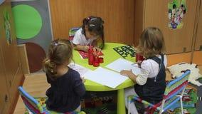Little girls preschoolers drawing stock video footage