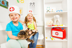 Little girls pretending to be doctors veterinarian Stock Photo