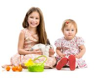 Little girls and rabbit Stock Photo