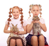 Little girls with rabbits in  hands Stock Photo