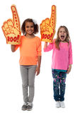 Little girls raises arms with foam finger Royalty Free Stock Photo