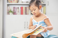 Little girls reading book royalty free stock photo