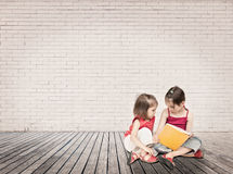 Little girls reading a book Stock Photos