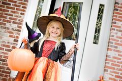 Halloween: Smiling Witch After Getting Trick Or Treat Candy royalty free stock photography