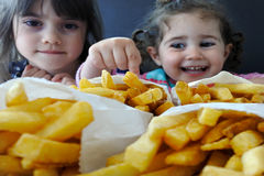 Little girls ready to eat fast food Royalty Free Stock Image
