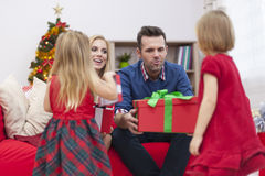 Little girls receiving presents Stock Photos