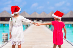 Little girls in red hats during Christmas vacation Royalty Free Stock Photos