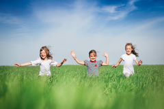 Little girls running on the field Royalty Free Stock Image