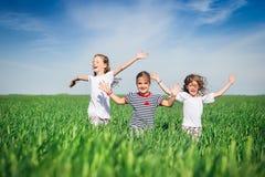 Little girls running on the field Stock Photo