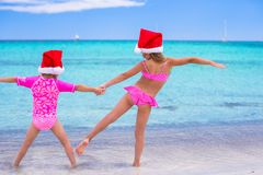 Little girls in Santa hats during summer vacation Stock Images