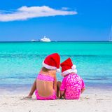 Little girls in Santa hats during summer vacation Stock Photography