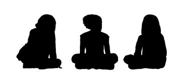 Little girls seated silhouettes set 2. Black silhouettes of three little girls age 5-10 seated on the floor face to the onlooker in different postures Stock Photos