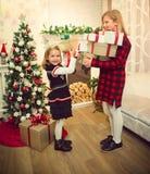 Little girls sharing presents Stock Photo