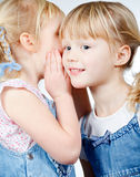 Little girls sharing a secret Royalty Free Stock Photo