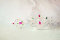 Little girls shiny crown and magic wand and chiffon dress. selective focus Stock Photos