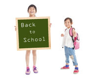 Little girls showing back to school Royalty Free Stock Photography
