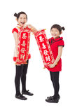 Little girls showing couplets for happy chinese new year Stock Images