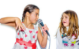 Little girls singing with microphone royalty free stock images