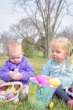 Little girls sitting with the Easter baskets outside stock photography