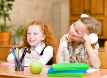 Little girls sitting and studying at school class Royalty Free Stock Image